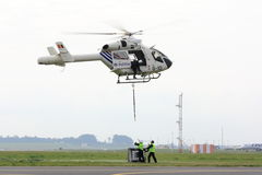 Helicopter picking up load Royalty Free Stock Images