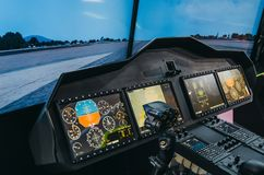 Helicopter pilot cabin and control panel with steering wheel, simulator. Stock Photo