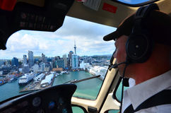Helicopter pilot fly over Auckland financial center New Zealand Stock Photography