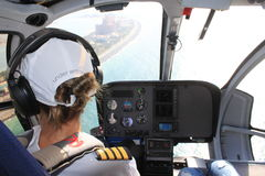 Woman Helicopter pilot flying over the hotel Atlantis The Palm Dubai, UAE Royalty Free Stock Photography