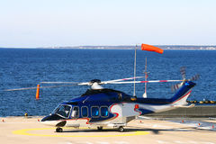 Helicopter on the platform. Helicopter on the platform near the sea Royalty Free Stock Image