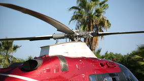 A helicopter prepares for takeoff. Sequence stock video footage