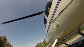 Helicopter is preparing to take off. Low-flying helicopter in the highlands. Small lightweight aviation. Bottom view on
