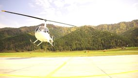 Helicopter take-off. Small lightweight aviation. bottom view on a propeller blades