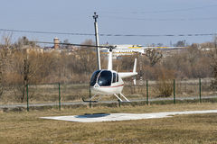 Helicopter R44 Robinson Raven 1 flying Stock Photo