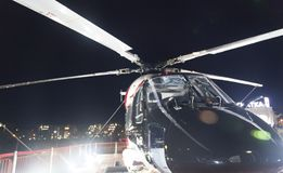 Helicopter at night Stock Photography