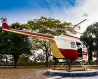 Helicopter ready to take off to touch the beauty of vibrant clouds stock photo