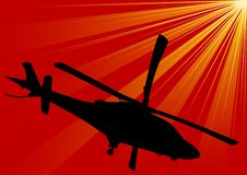 Helicopter on red sky Stock Photography