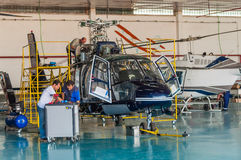 Helicopter repair team Stock Image