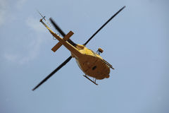 Helicopter rescue. Bottom view of an Italian mountain rescue helicopter during take-off Royalty Free Stock Photography