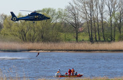 A Helicopter rescue a man and a lifeguard boat Royalty Free Stock Images