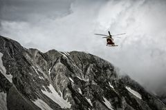 Helicopter Rescue on the Mountain royalty free stock image