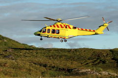 Helicopter rescue. Runde island rescue by emergency helicopter stock photos