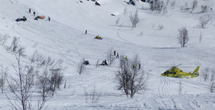 Helicopter rescue. After snowmobile accident in mountain Stock Photo