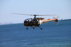 Helicopter rescue training. Portuguese Navy Helicopter rescue training over the sea Royalty Free Stock Photography