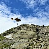 Helicopter Rescue from Lac Blanc Trail. Helicopter rescues hiker from rocky trail enroute to Lac Blanc in the French Alps Stock Images