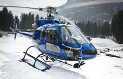 Helicopter resting on the snow - front Royalty Free Stock Image