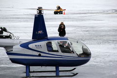 Helicopter ride taking off from Lake George,New York,Winterfest,February 2nd,2013 Stock Photo