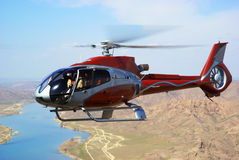 Helicopter on river. In desert Royalty Free Stock Image