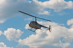 Helicopter Robinson R44 Raven II in flight Stock Photos