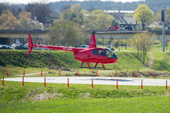 Helicopter Robinson R44 in Vilnius, Lithuania. VILNIUS - APR 17: Helicopter Robinson R44 on Apr. 17, 2014 in Vilnius, Lithuania. The Robinson R44 is a four-seat Stock Image