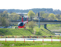 Helicopter Robinson R44 in Vilnius, Lithuania. VILNIUS - APR 17: Helicopter Robinson R44 on Apr. 17, 2014 in Vilnius, Lithuania. The Robinson R44 is a four-seat Stock Photography