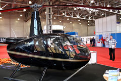 Helicopter. Robinson R44 Raven2. MOSCOW - MAY 19: Helicopter. Robinson R44 Raven2 at the international exhibition of  the helicopter industry, HeliRussia on May Royalty Free Stock Image