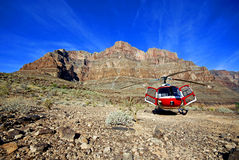 Helicopter in Rocky mountains Royalty Free Stock Photo