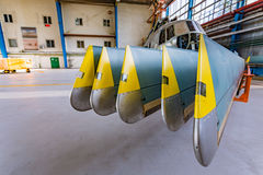 Helicopter rotor blades in hangar Stock Images