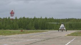 Helicopter on the runway. The aviation disaster medicine. Medical helicopter rides on the runway stock video