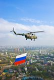 Helicopter with russian flag over Moscow Royalty Free Stock Images