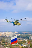 Helicopter with russian flag over Moscow Stock Photography