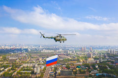 Helicopter with russian flag over Moscow at parade Stock Photo