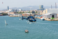 Helicopter service in the port of Barcelona Stock Images