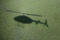 Helicopter shadow on marsh. Stock Photo