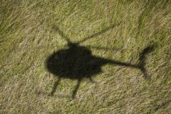 Helicopter shadow over field Stock Photos