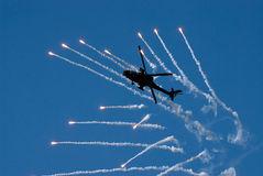 Helicopter shooting flares Royalty Free Stock Photo