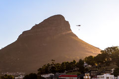 Helicopter Signal Hill Cape Town Fire. Signal Hill Cape Town Fire in the summer months when fire risk is at a peak. Helicopters carrying water try put out the Stock Images