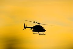 Helicopter silhouette. Flying helicopter silhouette Royalty Free Stock Image
