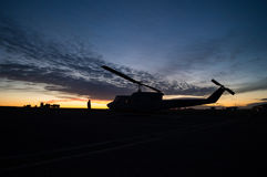 Helicopter silhouette. Military helicopter silhouette during sunrise Stock Photo