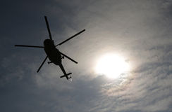 Helicopter silhouette sun above Royalty Free Stock Photo