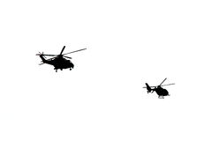 Helicopter silhouettes Royalty Free Stock Photography