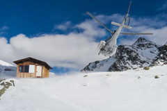 Helicopter on a ski slope in Gressoney Ski Resort, Monterosa, Italy. Royalty Free Stock Photos