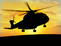 Helicopter Sky. Helicopter silhouette with the sunshine in the bottom Royalty Free Stock Photo
