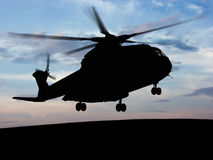 Helicopter Sky. Helicopter silhouette with the sunshine in the bottom Royalty Free Stock Image
