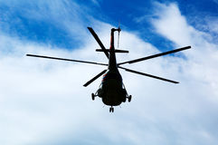 Helicopter, sky and clouds. Russian helicopter Mi-8 Stock Photo