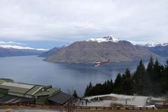 Helicopter at Skyline above Queenstown New Zealand stock photography