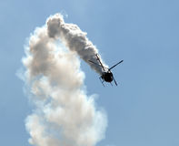 Helicopter in smoke Royalty Free Stock Image