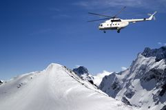 Helicopter in snowy mountains Royalty Free Stock Image