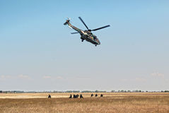 Helicopter and soldiers Stock Images